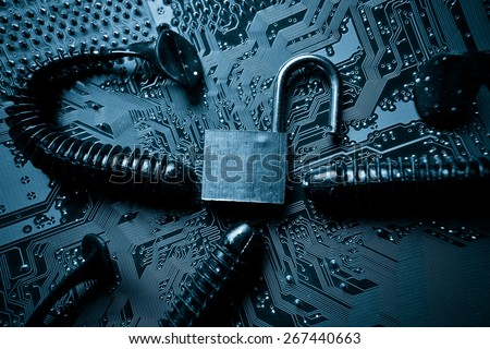 computer security breach due to worm attack - worm on computer circuit board with open security lock - stock photo