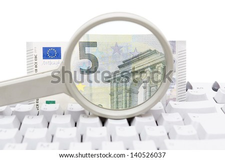 Computer security concept with keyboard, magnifying glass and money - stock photo