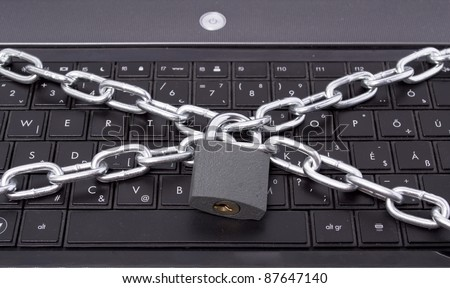 computer security lock light chain and padlock - stock photo