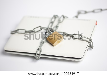 computer security with laptop and chain - stock photo