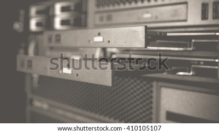Computer Server and  CD or DVD drive in datacenter , process in vintage black and white style. - stock photo