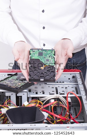 computer support engineer troubleshooting an office computer. - stock photo