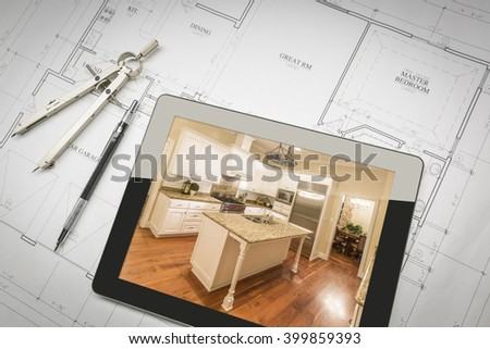Computer Tablet Showing Finished Kitchen Sitting On House Plans With Pencil and Compass. - stock photo