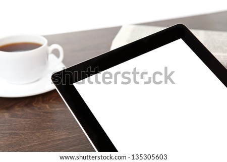 computer tablet with isolated screen on a table at a businessman in office - stock photo