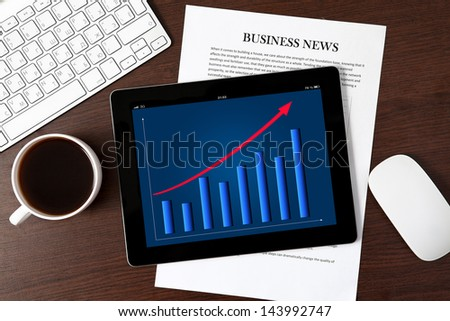 computer tablet with the schedule on the screen on the table of a businessman - stock photo