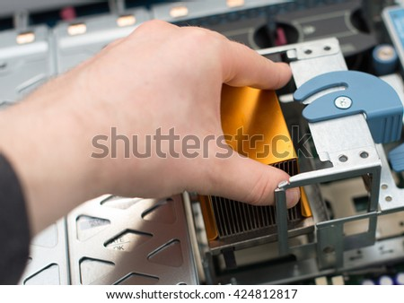 Computer technician installing CPU into motherboard. - stock photo