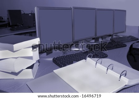 Computer training room with books in laboratory - stock photo