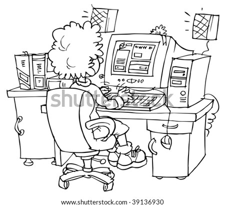 computer user sitting at the desk in front of computer - stock photo