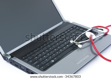 Computer virus concept with laptop and stethoscope - stock photo