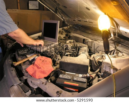 Computers are used to communicate with auto electronics - stock photo