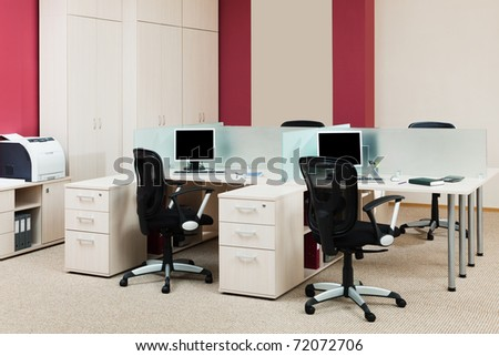 computers on a desk in a modern office - stock photo