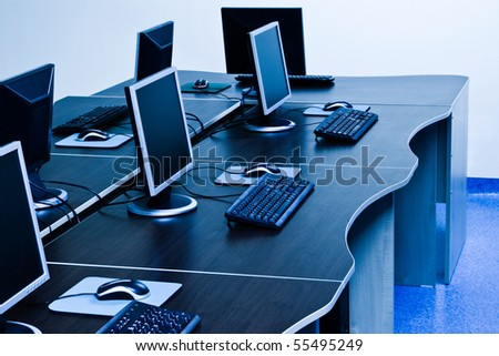 computers with LCD screens in IT office - stock photo