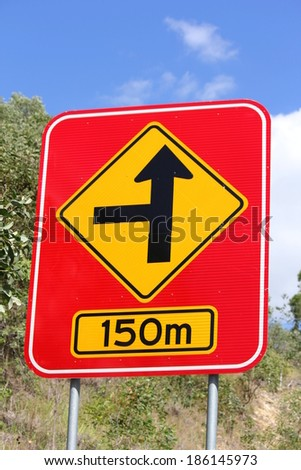 Concealed Road Warning sign 150m 2 - stock photo