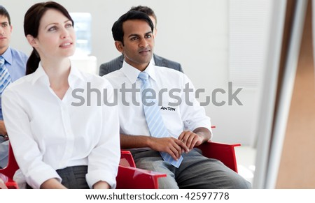 Concentrated business people at a conference in the office - stock photo