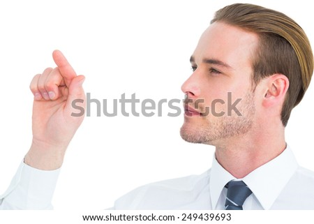 Concentrated businessman pointing with his finger on white background - stock photo