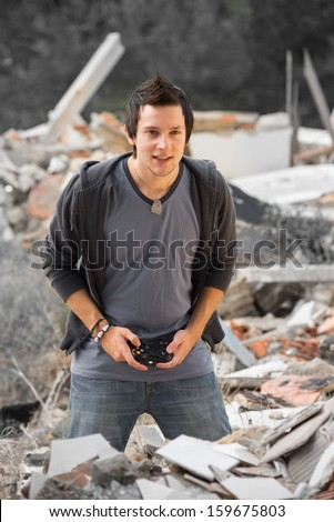 Concentrated gamer enjoying his hobby in gloomy surroundings, a concept - stock photo