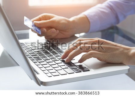 Concept about online payment on internet and e-commerce, woman at home typing credit card number on computer - stock photo