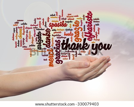 Concept abstract thank you word cloud held in hands in different languages or multilingual for education or Thanksgiving Day, appreciation, multicultural, friendship, tourism travel over rainbow sky - stock photo