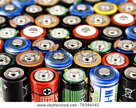 Concept background of colorful batteries - stock photo