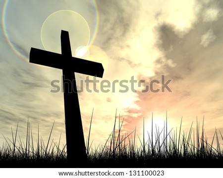 Concept conceptual black cross or religion symbol silhouette in grass over a sunset or sunrise sky with sunlight clouds background,metaphor to god,Christ,Christianity,religious,faith,Jesus or belief - stock photo