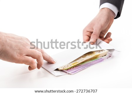 Concept - corruption. Businessman in a suit takes a bribe - stock photo
