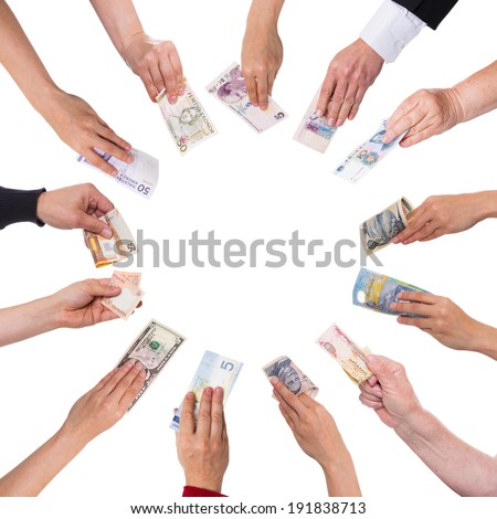 concept crowdfunding with a lot of hands with different currencies - stock photo
