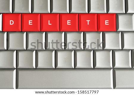 Concept delete spelled on metallic keyboard  - stock photo