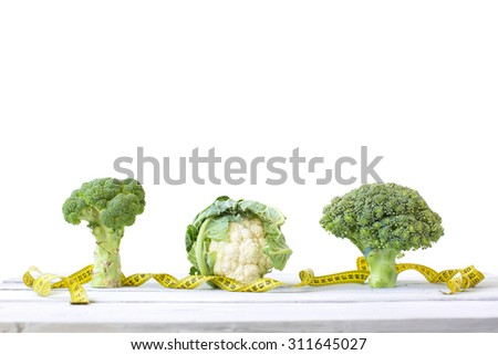 Concept diet. Cabbage, broccoli, and cauliflower on a white background. - stock photo