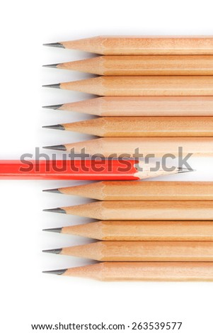 Concept different thinking, presented by red pencil and brown pencils in row - stock photo