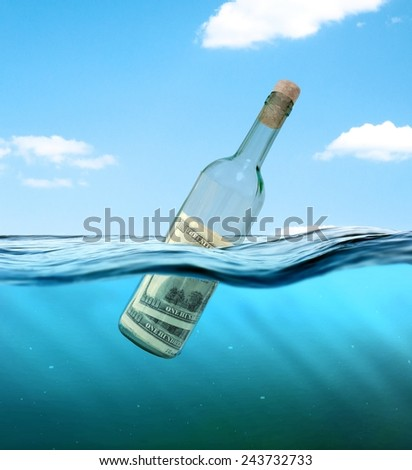"Concept  ""financial assistance"". Bottle of money floating in the water. - stock photo"