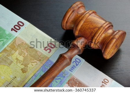 Concept For Corruption, Bankruptcy, Bail, Crime, Bribing, Fraud, Auction Bidding. Judges or Auctioneer Gavel, Soundboard And Euro Cash On The Rough Black Wooden Textured Table Background. - stock photo