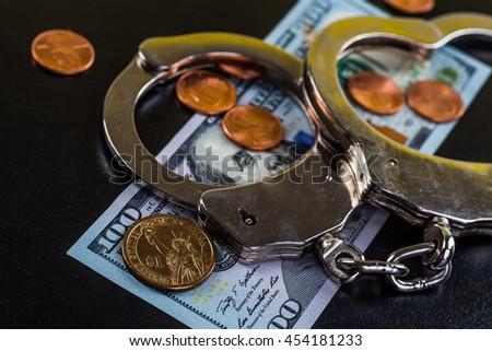 Concept For Corruption, Bankruptcy Court, Bail, Crime, Bribing, Fraud, Soundboard And Bundle Of Dollar Cash  - stock photo