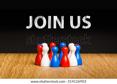 Concept for join us, join our team with white chalk text. Red white blue pawn figures and black background on oak. - stock photo