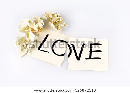 Concept for lost of love or broken love , love on torn paper - stock photo