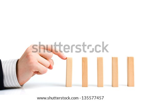 Concept for solution to a problem by stopping the domino effect - stock photo