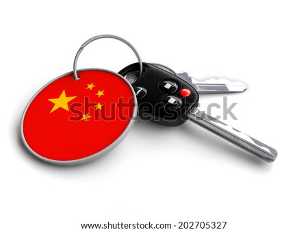 Concept for vehicles made in a specific country. Car industry concept of keys with country flag as key ring. Cars made in China. - stock photo
