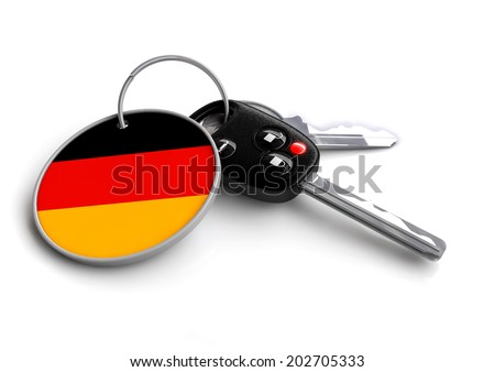 Concept for vehicles made in a specific country. Car industry concept of keys with country flag as key ring. Cars made in Germany. - stock photo