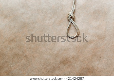 concept hangman's knot on kraft paper background soft light - stock photo
