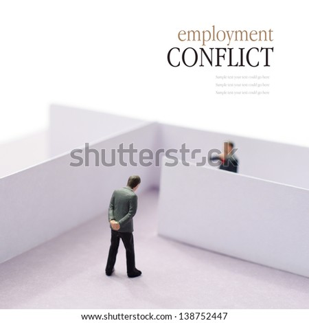 Concept image depicting a situation of employment conflict or tension in the work place. Copy space. - stock photo