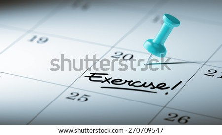 Concept image of a Calendar with a blue push pin. Closeup shot of a thumbtack attached. The words Exercise! written on a white notebook to remind you an important appointment. - stock photo