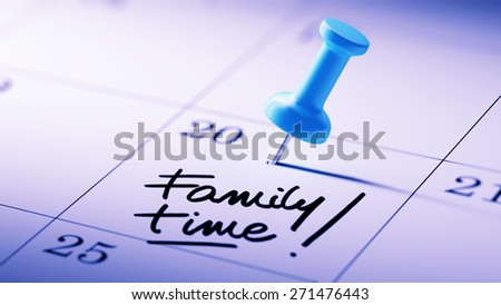 Concept image of a Calendar with a blue push pin. Closeup shot of a thumbtack attached. The words Family Time written on a white notebook to remind you an important appointment. - stock photo