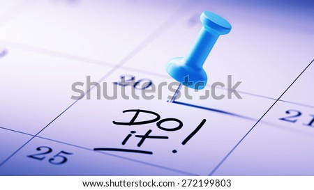 Concept image of a Calendar with a blue push pin. Closeup shot of a thumbtack attached. The words Do it written on a white notebook to remind you an important appointment. - stock photo