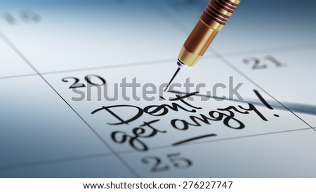 Concept image of a Calendar with a golden dart stick. The words Don't get angry written on a white notebook to remind you an important appointment. - stock photo