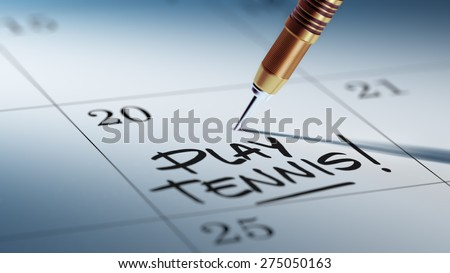 Concept image of a Calendar with a golden dart stick. The words Play Tennis written on a white notebook to remind you an important appointment. - stock photo
