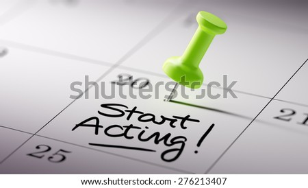Concept image of a Calendar with a green push pin. Closeup shot of a thumbtack attached. The words Start Acting written on a white notebook to remind you an important appointment. - stock photo