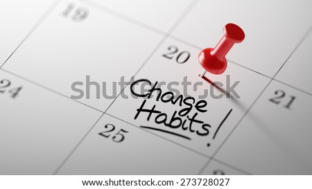 Concept image of a Calendar with a red push pin. Closeup shot of a thumbtack attached. The words Change Habits written on a white notebook to remind you an important appointment. - stock photo
