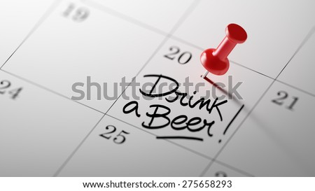 Concept image of a Calendar with a red push pin. Closeup shot of a thumbtack attached. The words Drink a beer written on a white notebook to remind you an important appointment. - stock photo