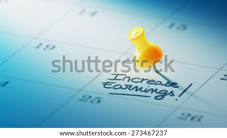 Concept image of a Calendar with a yellow push pin. Closeup shot of a thumbtack attached. The words Increase Earnings written on a white notebook to remind you an important appointment. - stock photo