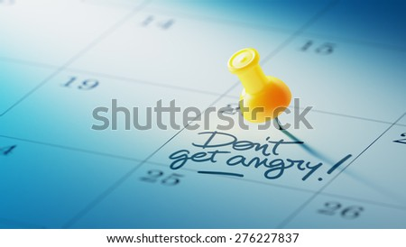 Concept image of a Calendar with a yellow push pin. Closeup shot of a thumbtack attached. The words Don't get angry written on a white notebook to remind you an important appointment. - stock photo