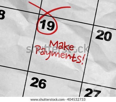 Concept image of a Calendar with the text: Make Payments - stock photo